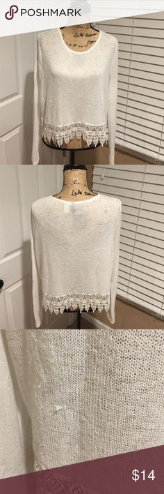 Divided sweater with lace Divided sweater with lace is beautiful it does have a few pulls in place.  The lace on the bottom of this sweater is beautiful. Divided Sweaters