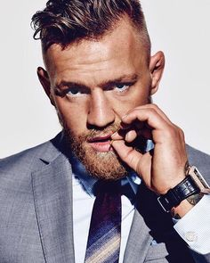 Love this shot of World Champion Conor McGregor wearing a David August Couture…