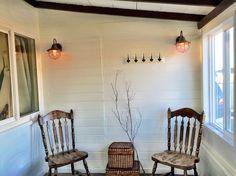 edison bulbs in vintage housing, white walls