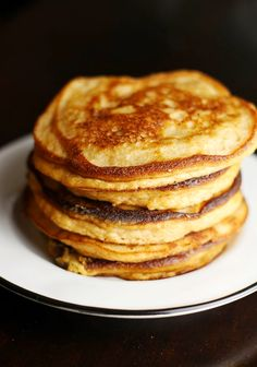 This healthier take on pancakes using coconut flour, applesauce, coconut oil, and eggs will get your day started on the right track! Good morning! Grab a seat and settle in for some pancake stories...
