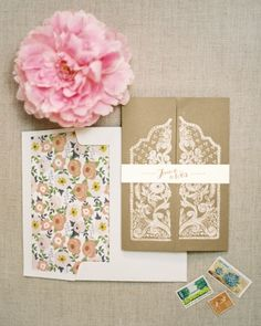 Letterpressed foldout invites depicting traditional Indonesian door panels for a destination wedding in Bali