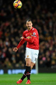 Manchester United's Swedish striker Zlatan Ibrahimovic plays the ball during the English Premier League football match between Manchester United and...