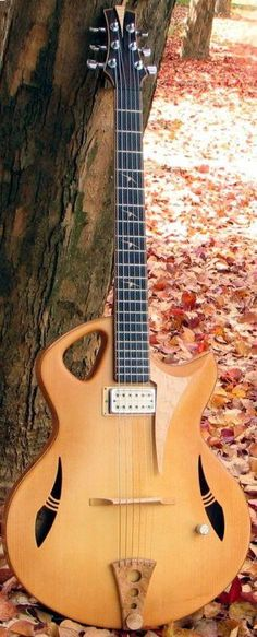 "[ƒrettedchordophone 2014] Murry Kuun ""Spitfire"" Archtop Guitar ~ https://www.pinterest.com/lardyfatboy/"