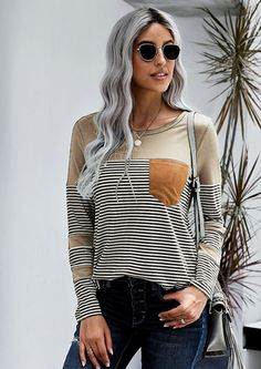 Our trendy Willow Pinstripe Pocket Detail Long Sleeve Top is the perfect sweater for the cold winter's days. Wear it with your pair of jeans for a casual look and it works versatile hues for the cold season with this leopard and pink stripes on the sleeves sweater – great for dressed down your daytime look.