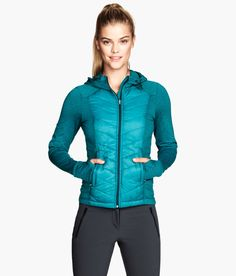 Turquoise fitted fleece jacket with padded front and back sections. Hood with elasticized drawstring, side pockets, and thumb holes at cuffs. | H&M Sport