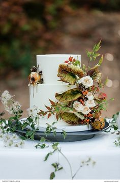 Red haired bride in an autumn inspired bridal shoot with hues of orange and red | Juliette Bisset Photography