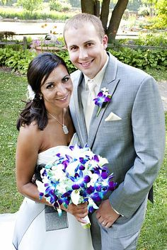 Me Gusta!   Blue Orchids with...white calla lilies, aqua hydrangeas, and stephanotis.  Boutonnierre: one blue orchid, two stephanotis.