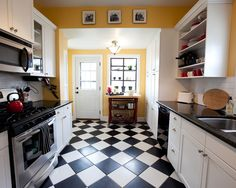 love the black and white tiles with yellow accents