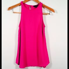 J. Crew Pink Tank The J. Crew Pink Tank is perfect top to take you from day to night! It features a key hole back with button closer. This item is in great condition but it does have a tiny snag on the front. ( See Photos ) Made out of 100% Viscose J. Crew Tops Tank Tops