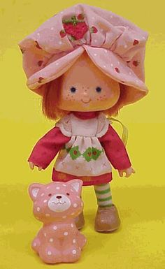 Strawberry Shortcake. I had many of the Strawberry Shortcake dolls growing up! Also had the Trolley,Gazebo, Bicycle and Carry Case shaped like a strawberry! My bedroom was completely decked out in strawberry shortcake as well!