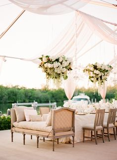 Floral Chandeliers & Romantic Drapery at Outdoor Reception | Photography: KT Merry Photography. Read More: http://www.insideweddings.com/weddings/a-gorgeous-and-elegant-outdoor-florida-wedding/536/