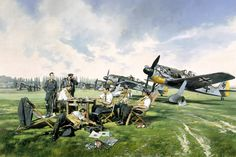 """Pilots of Jagdgeschwader 2 """"Richthofen"""" relax by their FW190 fighters in France, 23rd June 1942."""
