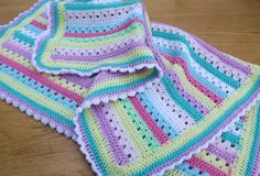 Stripy crochet baby blanket. Love the candy colours and the edging.