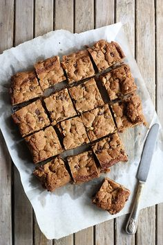 Whole Wheat Chocolate Chip Cookie Bars by Completely Delicious, so yummy - I added a couple of tablespoons of peanut butter and cut back the butter to half a cup - almos better than choc. chip cookies - YUM!