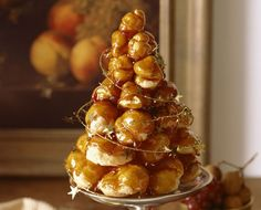 This croquembouche recipe for a traditional French wedding cake features vanilla cream-filled profiteroles dipped in handmade caramel. Learn how to make croquembouche. 13 Desserts, Desserts To Make, Christmas Desserts, Thanksgiving Desserts, Christmas Goodies, Plated Desserts, Christmas Gifts, Classic French Desserts, Truffles
