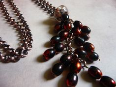 This is a gorgeous necklace and bracelet collection is entirely handcrafted. These two beautiful pieces are made with antique copper chain and a dazzling array of amber and black colored rice beads. Also incorporated in this design are beautiful black, cream and gold sparkling swirl Murano glass beads. This collection is beautiful for fall fashion and would be a great gift.   www.etsy.com/shop/natureslace  www.facebook.com/natureslace