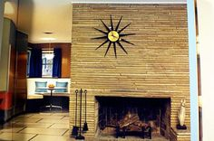 Retro mid-century fireplace wall and fabulous sunburst clock