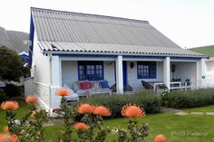 This lovely seaside cottage is in Beach Road, Kleinmond, Western Cape, RSA. / As jy op die stoepie van hierdie mooi huisie sit, kan jy die walvisse in die diepblou see dophou! Farmhouse Architecture, Modern Farmhouse Exterior, Farmhouse Plans, Weekend Cottages, African House, Little White House, Cottage Plan, Cottage Ideas, Log Cabin Homes