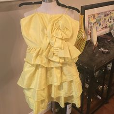 WOMENS sz 8 yellow mini dress by Arden B This bright yellow dress was worn once and zips up the back and is strapless.  There are tiny straps if you choose to use them. It has a gathered rosette on the front right. Arden B Dresses Mini