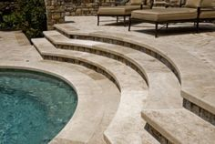 Hand-cut Peruvian sculptural travertine steps lead to the spa from a lounging terrace.