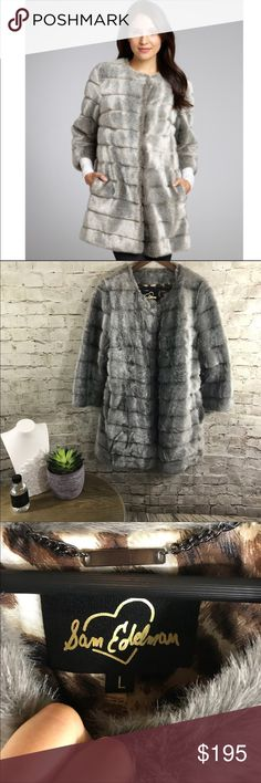 """Sam Edelman faux fur silver winter coat In excellent condition. Worn just once. Faux vegan  mink like silver grey fur. Size Large. Total length 33"""", 3/4 sleeve length, hook closure , very warm. Sam Edelman Jackets & Coats"""