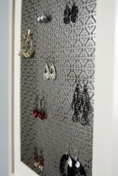10 DIY Jewelry Holders | You Put It On.  I love the radiator one!  I went to Hobby Lobby and bought a sheet of decorated metal that looks like a radiator grate.  It was only $12.  And I got the frame for $3 at Good Will.