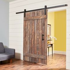 If youve investigated rustic barn doors youve probably gotten sticker shock. But we can help. In this article well show you how to build a simple barn door including how to distress new pine boards for a weathered look. Wooden Barn Doors, Rustic Doors, Barn Wood, Sliding Door Design, Diy Sliding Barn Door, Sliding Doors, Diy Barn Door Hardware, Building A Barn Door, Interior Barn Doors