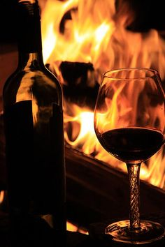 A fire and red wine