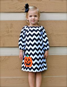 Why buy it when you could make it? Basic peasant dress pattern with fall fabric and Halloween applique | Toddler-girls long sleeve brown chevron dress with orange pumpkin applique- 6-12mo,12mo,18mo,2,3,4,5,6,7/8. $40.00, via Etsy.