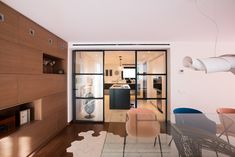 Glass wall. open kitchen. dining room. hexagon tiles