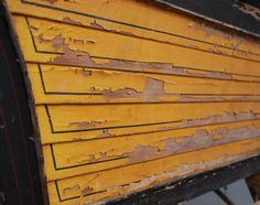 Detail of flaking paint on JD Patterson 1889 horse-drawn sleigh  #wood #antique #artifact #yellow