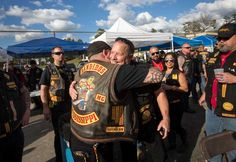 Jeff Pike, former Bandidos Motorcycle Club president, center-right, is greeted…