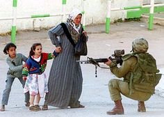 Israeli soldier pointing his gun at dangerous Islamist school girls.