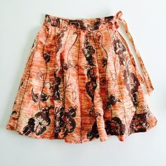 Odille skirt Faux-wrap a-line skirt with side tie and zide zip. Copper and brown print with sequins detail. Fully lined. Size 4. Anthropologie Skirts A-Line or Full