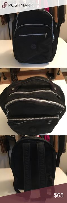 Black Kipling backpack 🎥 In excellent condition! A couple of spots on the inside that I'm sure would wash off, but they aren't very noticeable. Spacious and very comfortable bag, I love it, but i just don't have use for it anymore. Padded compartment in the back for a tablet or laptop. 2nd compartment in the front has a few spaces for pens, cards, phone, etc! Price is firm for the most part! Video on Instagram @abeesnook 🐝 The little 🐒 is included, it's the plush one! Kipling Bags…