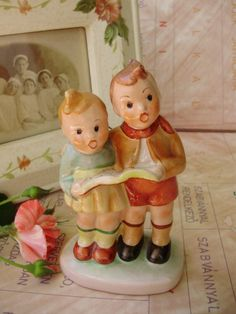 Vintage Hungarian porcelain figurine,singing little boy and girl ,handpainted by VintageMarketArt on Etsy