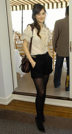 Zooey Deschanel makes the shorts and tights ensemble look accessible and high-end Pantyhose Outfits, Black Pantyhose, Black Tights, Black Shorts, Nylons, Shorts With Tights, Tights Outfit, Zooey Deschanel Style, Zooey Dechanel