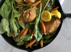 Skillet Roasted Chicken Thighs with Dandelion Greens + Baby Carrots recipe from Food52