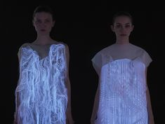 2 Gaze Activated Dresses by Ying Gao   Gao's series is comprised of two (2) dresses, made of photoluminescent thread and imbedded eye tracking technology, and is activated by a spectators' gaze.