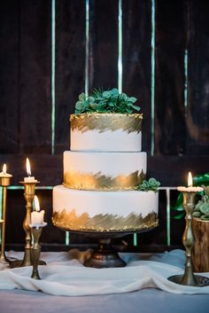 gold leaf wedding cake topped with succulents