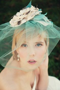 Be Romantic. Flower Birdcage blusher veil in mint green , with vintage brooch, and feathers. $228.00, via Etsy.