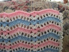 Naptime Ripple Baby Afghan - pretty, lacy, with a shell in the ripple. I would love to see this in lite green, yellow and white..........I know, make one, right?