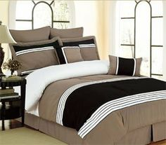 """8 Piece Willow Queen Size Comforter Set - Taupe, Black and Bone by Ramallah. $89.99. The pillow shams measure 21"""" x 27"""" (53 x 69 cm). The dust ruffle measures 60"""" x 80"""" x 14"""" drop (152 x 203 x 36 cm). 2 Euro Shams measure 26"""" x 26"""" (66 x 66 cm). 1 Square cushion measures 18"""" x 18"""", 1 Oblong pillow measures 12"""" x 18"""". The comforter measures 90"""" x 92"""" (228 x 234 cm). This 8 piece comforter set includes 2 pillow shams, 2 toss pillows, 2 Euro shams and a dust ruffle."""