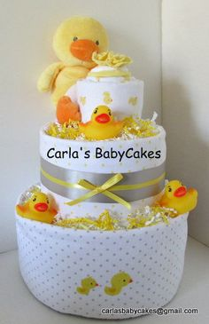 Duck Diaper Cake   Handmade item Materials: receiving blankets, disposable diapers, bottle, stuffed duck toy, scratch mittens, hat, bath toy, infant bodysuit