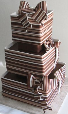 Try chocolate fondant to cover the cake and brown, gold and turquise stripes and ribbons