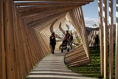 "Artist Thilo Frank's latest wooden installation snakes in a tunnel of timber in northern Denmark. Called ""EKKO,"" the installation comes to life with sound as visitors walk beneath the wooden frames. Urban Landscape, Landscape Design, Espace Design, Pergola, Landscaping Supplies, Shade Structure, Space Architecture, Parametric Architecture, In Vino Veritas"