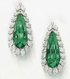 A pair of superb emerald and diamond pendants by Harry Winston