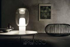 Buy the Yoko Table Lamp by Foscarini from our designer Lighting collection at Chaplins - Showcasing the very best in modern design. Italian Lighting, Luxury Lighting, Interior Lighting, Modern Lighting, Lighting Design, Light Table, Lamp Light, Everything Is Illuminated, Traditional Table Lamps