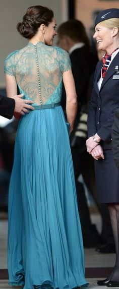 The intricate do was a perfect fit for her pleated teal Jenny Packam gown with lace details