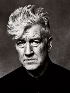 David Lynch by Mario Sorrenti. Simple contrasty light, on axis. This shot is all in the look (and the hair).